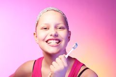 Teen girl with a toothbrush Stock Images