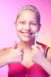 Teen girl with a toothbrush Royalty Free Stock Photography