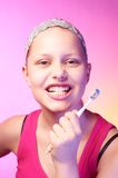 Teen girl with a toothbrush Stock Photography