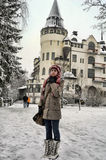 Teen girl tourist on background of Old hotel Valtionhotelli Royalty Free Stock Photography