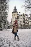Teen girl tourist on background of Old hotel Valtionhotelli Royalty Free Stock Photos