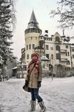 Teen girl tourist on background of Old hotel Valtionhotelli Royalty Free Stock Photo