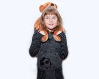 Teen girl with toy bear Stock Images