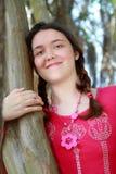 Teen girl tree. Beautiful teen girl dreaming by tree Stock Photos