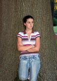 Teen girl and tree Royalty Free Stock Image