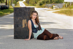 Teen Girl with a Trunk in the Street Royalty Free Stock Photography