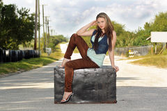 Teen Girl on a Trunk in the Street (2) Stock Photography