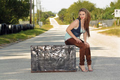 Teen Girl on a Trunk in the Street (4) Royalty Free Stock Photography