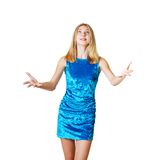 Teen girl trying to catch something. By hand she is in blue dress isolated over white Royalty Free Stock Photography