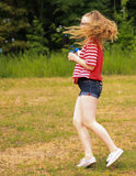 Teen girl twirls with bubbles. Teen girl in the park blowing bubbles and twirling around Stock Photos