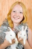 Teen  girl with two  rabbits Royalty Free Stock Images
