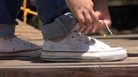 Teen Girl Tying Sneakers stock video footage