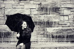 Teen Girl with Umbrella, Waterfall royalty free stock image