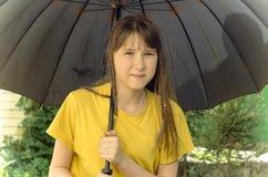 Teen girl under the big umbrella Stock Photography