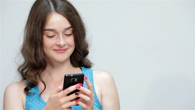Teen girl use mobile phone, making thumbs up stock video