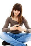 Teen girl using a cell phone Royalty Free Stock Image
