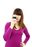Teen girl using cell phone. Isolated on white Royalty Free Stock Images