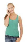 Teen girl using cell phone. Isolated on white background Royalty Free Stock Photography