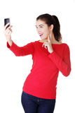 Teen girl using cell phone. Isolated on white Royalty Free Stock Image