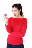 Teen girl using cell phone. Isolated on white Stock Photos