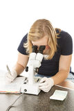 Teen Girl Using Microscope Royalty Free Stock Photos