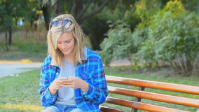 Teen girl using a smart phone. stock video footage