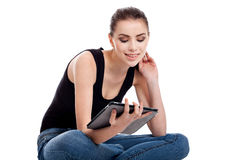 Teen girl using a tablet Stock Images