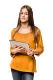 Teen girl using tablet computer. Royalty Free Stock Image