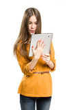 Teen girl using tablet computer. Stock Images
