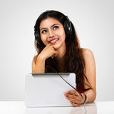 Teen girl using a tablet. Isolated over white stock photo