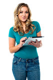 Teen girl using tablet pc Stock Photography
