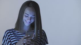 Teen girl using typing in smart phone stock video footage