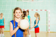 Teen girl with volleyball ball in sports hall royalty free stock photos