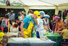 Teen girl volunteer treating biscuits plasterer royalty free stock photos