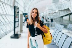 Teen girl waiting for international flight in airport departure terminal stock images