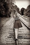 Teen Girl Walking Away on a Train Track Stock Photos