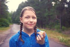 Teen girl walking in the forest in the rain Stock Images