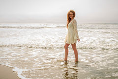 Teen girl walking in the ocean Stock Images