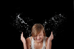 Teen girl washing her face with water Stock Photos