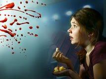 Teen girl watching horror movie with pop corn Stock Photo