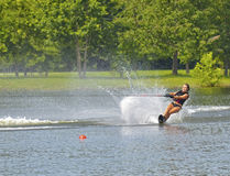 Teen Girl on Water Ski Course. A teenage girl going around a bouy on a water ski course during a competition stock image