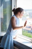 Teen girl wave on window Stock Images