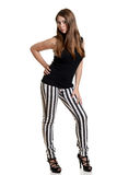 Teen girl wearing black white stripe pants Royalty Free Stock Photos
