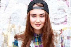 Teen girl. A teen girl wearing a cap on the street Royalty Free Stock Photos