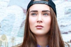 Teen girl. A teen girl wearing a cap on the street Stock Photo