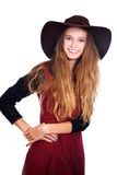 Teen girl wearing  dark brimmy hat Royalty Free Stock Photography
