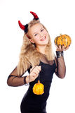 Teen girl wearing devil horns Stock Photo