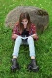 Teen girl reading book royalty free stock photo