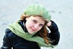 Teen girl wearing green beret royalty free stock photo