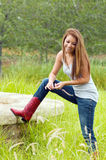 Teen Girl Wearing Jeans And Cowboy Boots Stock Image